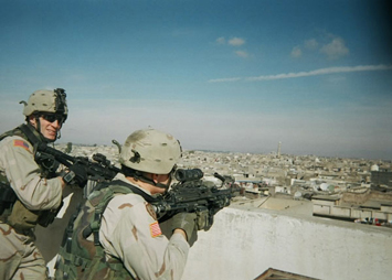 2nd Lt. Scott Smiley and another Soldier conduct overwatch in Iraq while deployed with the 25th Infantry Division in late 2004 or early 2005